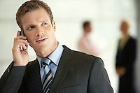 Businessman in Office Using Cell Phone close-up