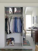inside of a business man closet with mirror