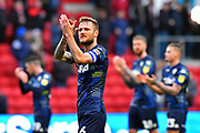 Liam Cooper (6) of Leeds United applauds the fans at full time after a 1-0 win over Bristol City during the EFL Sky Bet Championship match between Bristol City and Leeds United at Ashton Gate, Bristol, England on 9 March 2019.