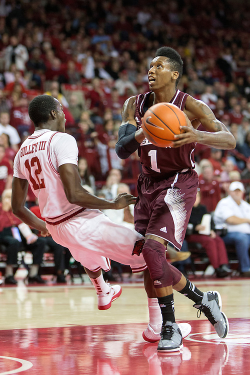FAYETTEVILLE, AR - JANUARY 23:  Fred Thomas #1 of the Mississippi State Bulldogs runs into Fred Gulley III #12 of the Arkansas Razorbacks at Bud Walton Arena on January 23, 2013 in Fayetteville, Arkansas. The Razorbacks defeated the Bulldogs 96-70.  (Photo by Wesley Hitt/Getty Images) *** Local Caption *** Fred Thomas; Fred Gulley III