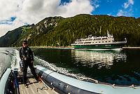 Un-Cruise small cruise ship Wilderness Explorer sailing out of Takatz Bay, Baranof Island, Inside Passage, Southeast Alaska USA.