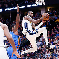 09 November 2017: Denver Nuggets guard Will Barton (5) goes for the layup past Oklahoma City Thunder forward Paul George (13) during the Denver Nuggets 102-94 victory over the Oklahoma City Thunder, at the Pepsi Center, Denver, Colorado, USA.