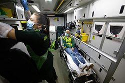© Licensed to London News Pictures. 11/04/2020. Manchester, UK. An exercise to review the patient route from referring hospital to initial assessment at Nightingale NW is executed , with Director of Estates and Facilities at Nightingale NW , JO WRIGHT (37) , playing the patient role inside an ambulance . The National Health Service is building a 648 bed field hospital for the treatment of Covid-19 patients , at the historical railway station terminus which now forms the main hall of the Manchester Central Convention Centre . The facility is due to open on Easter Monday , 13th April 2020 , and will treat patients from across the North West of England , providing them with general medical care and oxygen therapy after discharge from Intensive Care Units . Photo credit: Joel Goodman/LNP