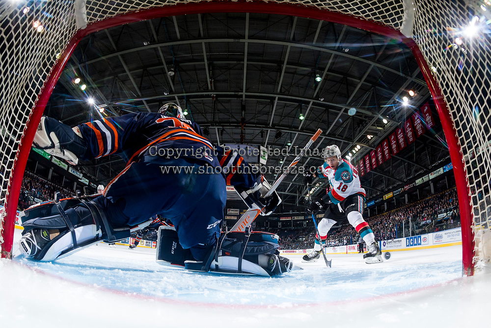 KELOWNA, CANADA - MARCH 31: Connor Ingram #39 of the Kamloops Blazers defends the net from a shot by Carsen Twarynski #18 of the Kelowna Rockets during the first period on March 31, 2017 at Prospera Place in Kelowna, British Columbia, Canada.  (Photo by Marissa Baecker/Shoot the Breeze)  *** Local Caption ***
