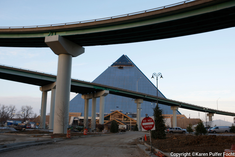 The Pyramid in Memphis, Tennessee, is being renovated by Bass Pro Shop. The city hopes the north end of Main Street in Memphis, will experience a renewal when Bass Pro Shops finishes construction. They plan to opens a mega store in spring of 2015, that will host a hotel, the new mega store will include a grand hotel, 600,000 gallons of water features; a cypress swamp with 100-foot-tall trees; an interactive National Waterfowling Heritage Center by Ducks Unlimited; and a breathtaking glass-floored cantilevering observation deck at the top of the 32-story steel pyramid. It is located just off the Mississippi River.