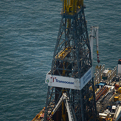 A view of the derek on the Transocean Discoverer Enterprise drill ship that remains idle as test continue on the cap placed at the BP Plc MC252 well site in the Gulf of Mexico off the coast of Louisiana, U.S., on Sunday, July 18, 2010. BP Plc said that a pressure test on its damaged Macondo well halted the flow of oil into the Gulf for the first time in three months. The oil spill, the biggest in U.S. history, had been spewing 35,000 to 60,000 barrels of oil a day since the drilling rig exploded on April 20. Photographer: Derick E. Hingle/Bloomberg
