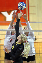 23 October 2015:  a battle at the net between Emily Hiebert(13), Ali Line(1) and Lexi Wallen(14) during an NCAA women's volleyball match between the Wichita State Shockers and the Illinois State Redbirds at Redbird Arena in Normal IL (Photo by Alan Look)