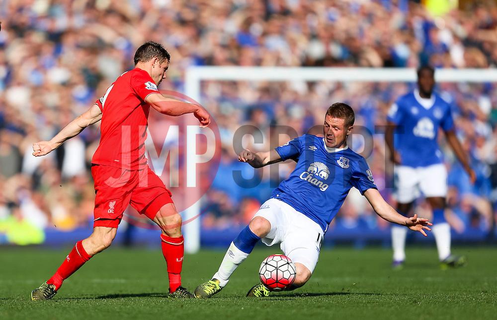 Everton's James McCarthy tackles James Milner of Liverpool  - Mandatory byline: Matt McNulty/JMP - 07966 386802 - 04/10/2015 - FOOTBALL - Goodison Park - Liverpool, England - Everton  v Liverpool - Barclays Premier League