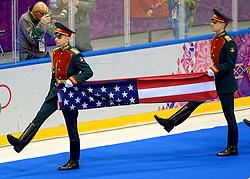 20-02-2014 IJSHOCKEY: OLYMPIC GAMES: SOTSJI<br /> De finale tussen USA en Canada wordt door Canada in de extra tijd door een golden goal met 3-2 gewonnen / De Amerikaanse vlag wordt binnengedragen voor de ceremonie en Klaas Jan van der Weij staat de teleurgestelde Amerikanen te fotograferen<br /> ©2014-FotoHoogendoorn.nl