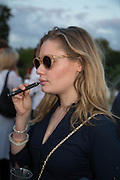 KEELEY WALKER SMOKING ELECTRIC CIGARETTE,  CHARLES FINCH'S CHUCS SWIMATHON 2013, SERPENTINE, Hyde Park, London. 4 July 2013.