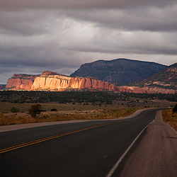 Scattered light illuminates the sandstone bluffs along Highway 12 near Navajo, N.M.