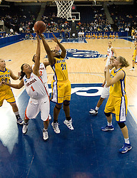 UCSB guard Meagan Williams (21) shoots past Virginia forward Lyndra Littles (1).  The #4 seed/#24 ranked Virginia Cavaliers defeated the #13 seed Santa Barbara Gauchos 86-52 in the first round of the 2008 NCAA Division 1 Women's Basketball Championship at the Ted Constant Convocation Center in Norfolk, VA on March 23, 2008