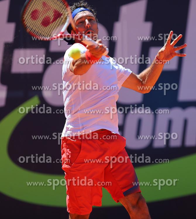 31.07.2013, Sportpark, Kitzbuehel, AUT, ATP World Tour, bet at home Cup 2013, Einzel Achtelfinale, im Bild Tennisspieler Juan MONACO (ARG) waehrend seiner Zweitrunden-Partie gegen Andreas HAIDER-MAURER (AUT) // during best of sixteen of bet at home Cup 2013 tennis tournament of the ATP World Tour at the Sportpark in Kitzbuehel, Austria on 2013/07/31. EXPA Pictures &copy; 2013, PhotoCredit: EXPA/ Eibner/ Tobias Eriksson<br /> <br /> ***** ATTENTION - OUT OF GER *****