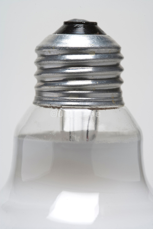 screw of a tungsten filament light bulb