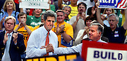 Presidential candidate John Kerry (center) makes a stop in Portland with former Governor Howard Dean )right) at his side. The two were treated to a huge welcoming crowd at Pioneer Square and even supported on the stand by friends, actors and musicians.