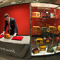 London April 24 2009  Laurence Fisher of Bonhams at a Photocall for Jeff Salmon Radio Collection. Made of Catalin, a brand of phenol-formaldehyde polymer resin allowed designers to create objects which  were in tune with the art deco period. It was revolutionary because it was possible to dye it any colour while in its resin form..The radios are being sold by collector Jeff Salmon, who worked at Sotheby's before opening the Decoratum mid-20th century furniture and design gallery in London...The collection will be auctioned by Bonhams in Knightsbridge as part of its Mechanical Music and Scientific Instruments sale on April 28...***Standard Licence  Fee's Apply To All Image Use***.Marco Secchi /Xianpix. tel +44 (0) 845 050 6211. e-mail ms@msecchi.com or sales@xianpix.com.www.marcosecchi.com