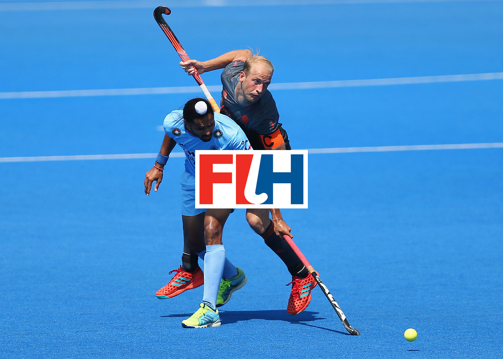 LONDON, ENGLAND - JUNE 20:  Billy Bakker of the Netherlands and Akashdeep Singh of India battle for the ball during the Pool B match between India and the Netherlands on day six of the Hero Hockey World League Semi-Final at Lee Valley Hockey and Tennis Centre on June 20, 2017 in London, England.  (Photo by Alex Morton/Getty Images)