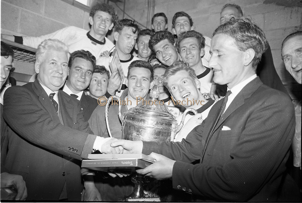 31/05/1964<br /> 05/31/1964<br /> 31 May 1964<br /> Presentation of Bradmola Cup at Tolka Park, Dublin. Grange United defeated Cherry Orchard 2-0. Picture shows Mr. Charlie Liddy,  (left) Chairman A.U.L. presenting sets of stockings for each member of the winning team to Mr. Sean Monahan, Honorary Secretary Grange United on behalf of Bradmola. Stockings were also presented to the losers.