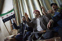 Free Syrian army soldiers singing songs against Bashar-al-Assad at one of their meetings with the independence flag in Talada, north west Syria, Syria, April 16, 2012. Photo by Daniel Leal-Olivas / i-Images...Contact..Andrew Parsons: 00447545 311662.Stephen Lock: 00447860204379