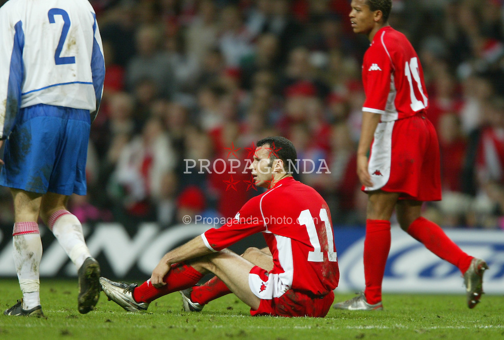 CARDIFF, WALES - Wednesday, November 19, 2003: Wales' Ryan Giggs sits dejected after losing 1-0 to Russia during the Euro 2004 Qualification Play Off match at the Millennium Stadium. (Pic by David Rawcliffe/Propaganda)