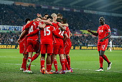 Jordan Henderson of Liverpool (2L) celebrates with his teammates after  scoring a goal to make it 0-1 - Photo mandatory by-line: Rogan Thomson/JMP - 07966 386802 - 16/03/2015 - SPORT - FOOTBALL - Swansea, Wales — Liberty Stadium - Swansea City v Liverpool - Barclays Premier League.