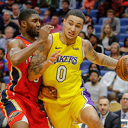 Feb 14, 2018; New Orleans, LA, USA; Los Angeles Lakers forward Kyle Kuzma (0) drives past New Orleans Pelicans guard E'Twaun Moore (55) during the second quarter at the Smoothie King Center. Mandatory Credit: Derick E. Hingle-USA TODAY Sports