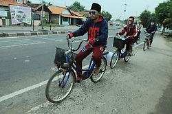 June 23, 2017 - Comal, Java, Indonesia - Muslim students (Santri) travelers during checking the condition of the bike to go home to celebrate Eid Al-Fitr in the area of Comal,  Central Java, on June, 23,2017. Various ways done travelers to get back to their hometown, one of them by using a bicycle. (Credit Image: © Dasril Roszandi/NurPhoto via ZUMA Press)