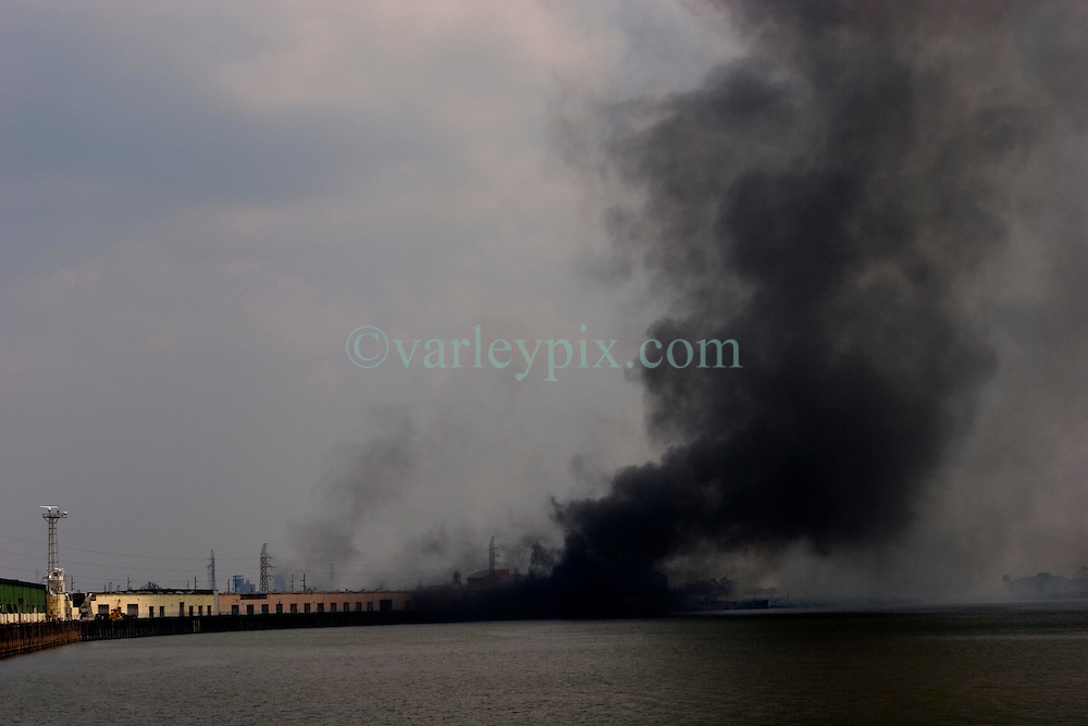 03 Sept  2005. New Orleans, Louisiana. Post hurricane Katrina.<br /> Mississippi burning. A fire rages out of control along the banks of the Mississippi in New Orleans.<br /> Photo Credit ©: Charlie Varley/varleypix.com