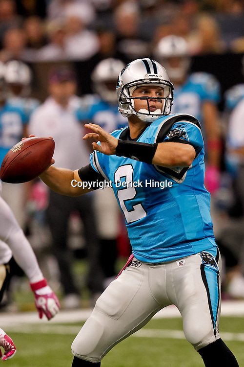 October 3, 2010; New Orleans, LA, USA; Carolina Panthers quarterback Jimmy Clausen (2) throws a pass against the New Orleans Saints during the second quarter at the Louisiana Superdome. Mandatory Credit: Derick E. Hingle