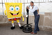 Actor and performing artist Nick Cannon and SpongeBob SquarePants appear at the Empire State Building, Wednesday, April 22, 2009, in New York, to announce that the building will 'Power Down' tonight for 60 seconds as part of Earth Day and Nickelodeon's ongoing Big Green Help initiative. (Photo by Diane Bondareff)