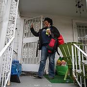 WASHINGTON, DC - NOV 16 :  Kimberly Gaines, a community organizer, waves to a neighbor from her porch, November 16, 2013, in Deanwood, Washington, DC. She and fellow community organizer Sheshat Walker, are working on a project called My Deanwood and photograph community members and write stories about them. (Photo by Evelyn Hockstein/For The Washington Post)