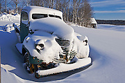old car covered in snow on farmland<br /> near Bracebridge<br /> Ontario<br /> Canada