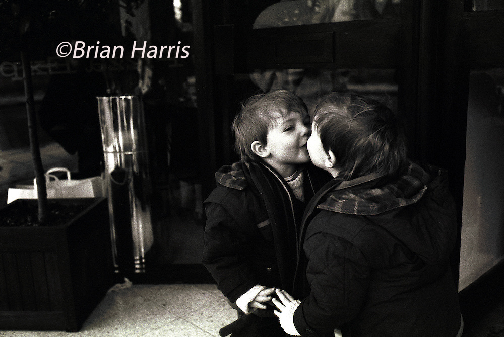 Kiss 7. Part of a series of images produced by the photographer while travelling  as a working photo-journalist on the subject of 'love'.<br /> The photographers son Jacob,4, kisses his reflection in Cambridge.<br /> Model released.