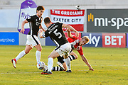Jayden Stockley (11) of Exeter City battles for possession with Luke Waterfall (5) of Lincoln City during the EFL Sky Bet League 2 match between Exeter City and Lincoln City at St James' Park, Exeter, England on 17 May 2018. Picture by Graham Hunt.