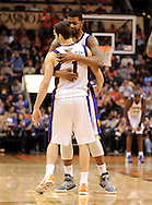 Nov. 23, 2012; Phoenix, AZ, USA; Phoenix Suns forward Markieff Morris (11) congratulates teammate guard Goran Dragic (1) during the game against the New Orleans Hornets in the second half at US Airways Center. The Suns defeated the Hornets 111-108 in overtime. Mandatory Credit: Jennifer Stewart-US PRESSWIRE