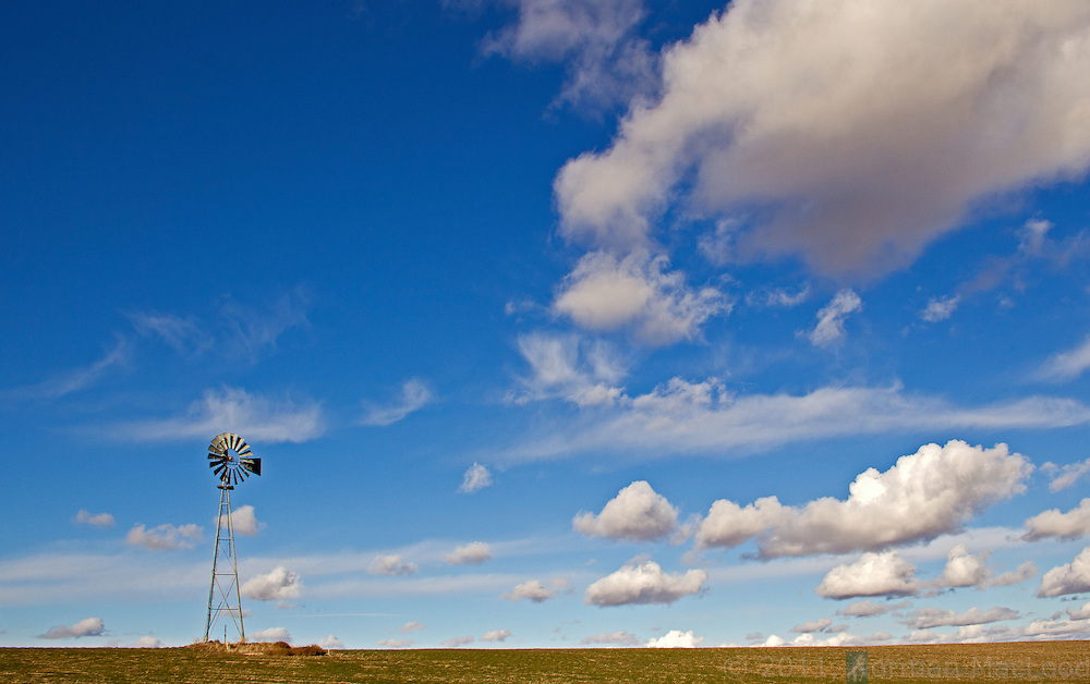 Eastern Washington windmill under a winter afternoon sky in dry-land wheat farming country