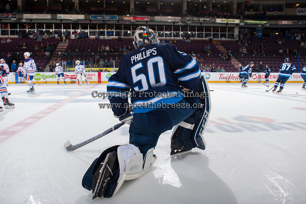 PENTICTON, CANADA - SEPTEMBER 9: Jamie Phillips #50 of Winnipeg Jets stretches on the ice during warm up against the Edmonton Oilers on September 9, 2017 at the South Okanagan Event Centre in Penticton, British Columbia, Canada.  (Photo by Marissa Baecker/Shoot the Breeze)  *** Local Caption ***