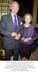 PROF.SIR CHRISTOPHER & LADY WHITE at a reception in London on 2nd April 2003.		PIP 20