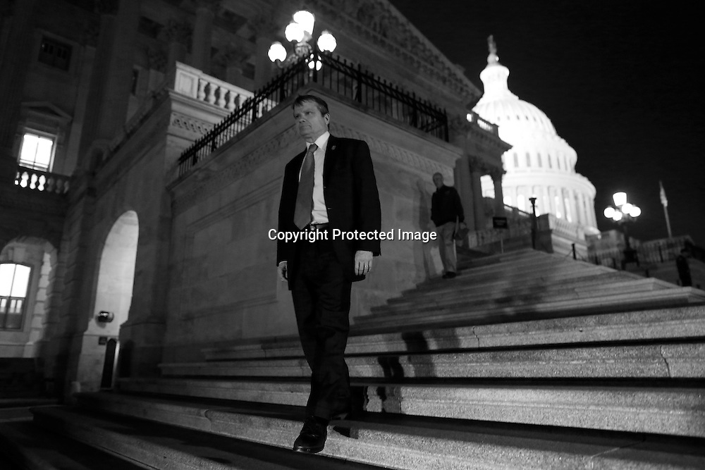Members of the U.S. House of Representatives depart after a late-night vote on fiscal legislation to end the government shudown, at the U.S. Capitol in Washington, October 16, 2013. The U.S. Congress on Wednesday approved an 11th-hour deal to end a partial government shutdown and pull the world's biggest economy back from the brink of a historic debt default that could have threatened financial calamity.