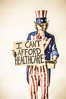 "An unle Sam character with a sign saying ""I can't afford healthcare"" and posing as if he is panhandling."