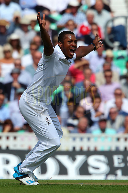 Chris Jordan of England appeals for the wicket of Virat Kohli of India during day one of the fifth Investec Test Match between England and India held at The Kia Oval cricket ground in London, England on the 15th August 2014<br /> <br /> Photo by Ron Gaunt / SPORTZPICS/ BCCI