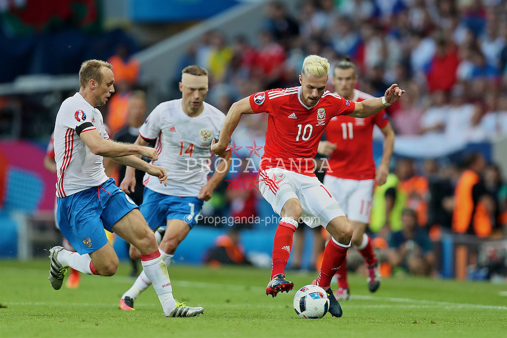TOULOUSE, FRANCE - Monday, June 20, 2016: Wales' Aaron Ramsey in action against Russia during the final Group B UEFA Euro 2016 Championship match at Stadium de Toulouse. (Pic by David Rawcliffe/Propaganda)