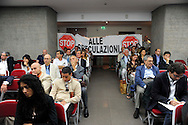 "Roma 23 Giugno 2009.Manifestazione degli sfrattati  e senza casa  aderenti al  «Bpm», Blocco Precario Metropolitano, ed  Action diritti in movimento, per protestare al sesto «Forum per l'edilizia e il territorio» organizzato da Il Sole 24 Ore, che si dovrebbe occupare anche del piano-casa..Rome 23 June 2009  .Demonstration of the evicted and homeless members of the ""Bpm"" Block Precario Metropolitano, and  Action Rights in motion, in protest at the sixth 'Forum for the building and the land' organized by Il Sole 24 Ore, which you should also take the plan-house.The banner reads:stop to the speculations"