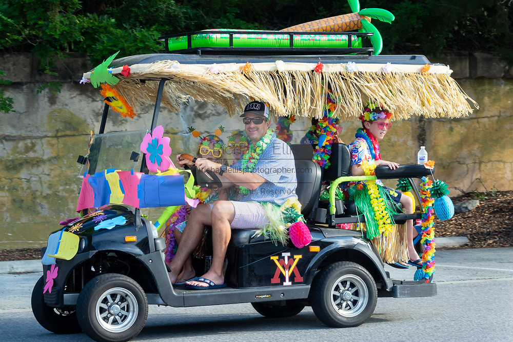 A golf cart float decorated in beach themes during the annual Independence Day golf cart and bicycle parade July 4, 2019 in Sullivan's Island, South Carolina. The tiny affluent Sea Island beach community across from Charleston holds an outsized golf cart parade featuring more than 75 decorated carts.
