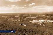 In 1972, Dr. Jerry Falwell walked through the woods of Liberty Mountain praying that the Lord would make it available to build an institution of higher learning with the sole purpose of training champions for Christ. This aerial view, taken in May 1977, shows the area that would become the Liberty Baptist College campus.