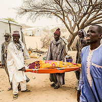 Dar Es Salam refugee camp, Lake region, Chad.<br /> <br /> Mohammad Abdullahi, 40, arrived in Dar Es-Salam refugee camp in January after to have flee Boko Haram violence in Baga, Nigeria. His wife, Awa Ouharba, 38, is dead during the night on April 10. 10 days ago she delivered her second child inside her tent in the camp only helped by other refugee women. 2 days after she reached Baga Sola hospital where she was admitted for an infection linked to the bad sanitarian situation during her delivery. But due to the lack of healthcare provide during her admission she finally died. <br /> <br /> <br /> Sylvain Cherkaoui/Cosmos for MSF