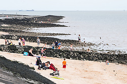 Families enjoying themselves on Concord Beach at Canvey Island, Essex