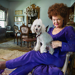 """Ruthie Lawler with her dog Honey Poo says, """"You can be 70-years-old and still dare to wear snakeskin pants, and I do. We're only here for a short time; you may as well have a little fun."""" (Christina Paolucci, photographer)."""