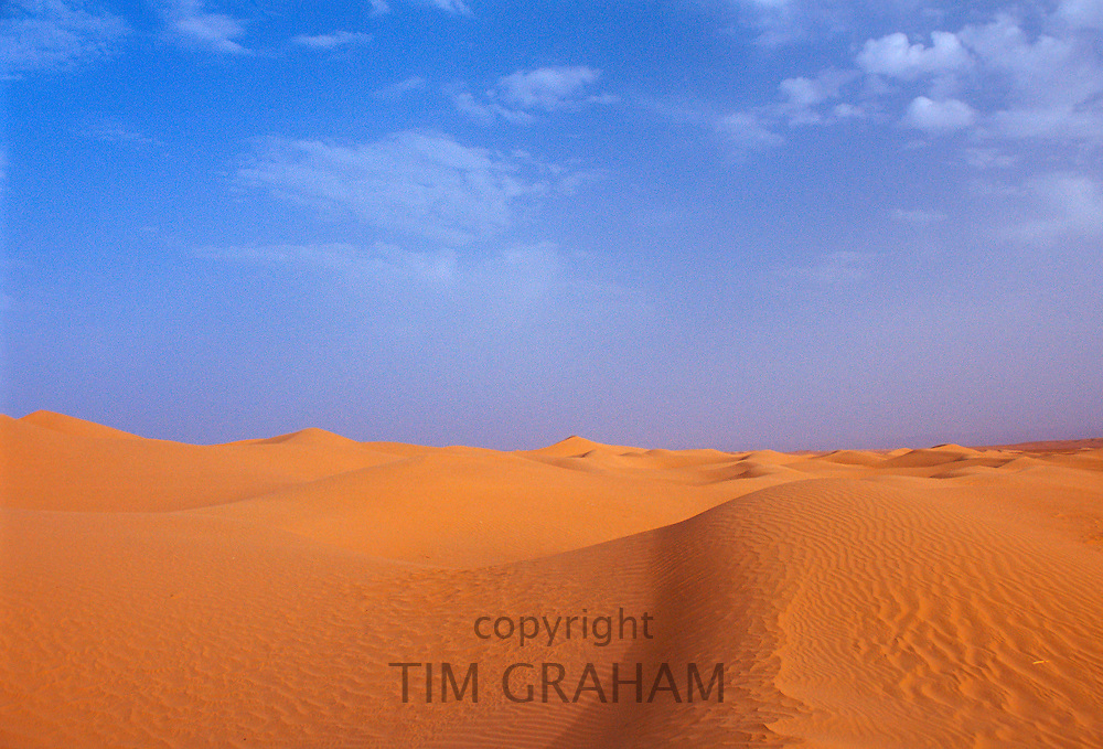 Blue skies and sand dunes in the Sahara Desert, Morocco