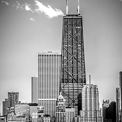 Chicago Hancock Building black and white picture  The Hancock building is one of the most famous and tallest skyscrapers in the world and is a popular attraction in Chicago.